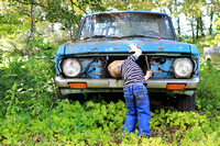 "1-5, boy, ""christine lewis photography"", junkyard, kids, little, old, photographer, pictures, portraits, professional, three, years, blue truck, green weeds, looking at the hood"